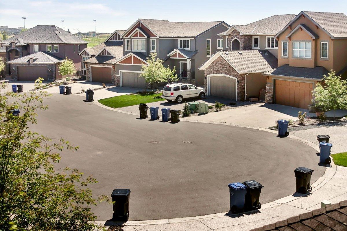 A row of houses on a cul de sac in a suburban neighborhood.